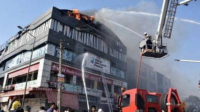 Surat: Fire fighting operations underway after a massive fire broke out at a coaching centre atop a four-storey building, in Sarthana area of Gujarat
