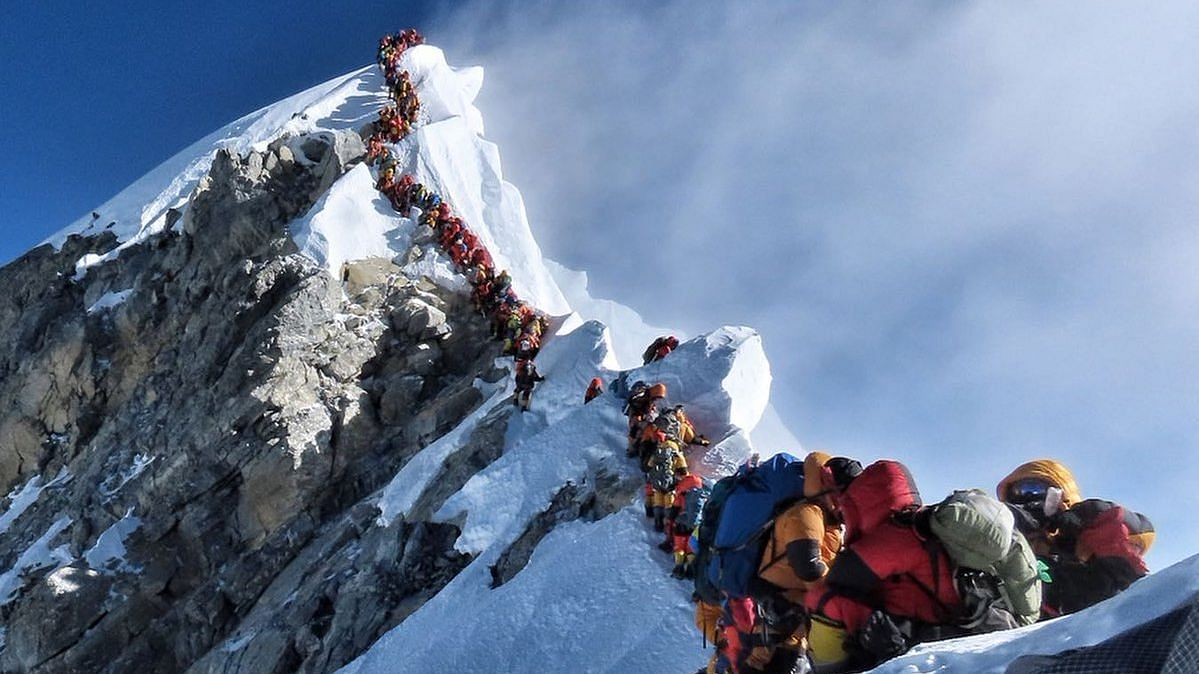 """A photo posted on 22 May, showing a long queue of mountaineers waiting to climb Mt Everest, made headlines across the world with many referring to it as """"traffic jam"""" on the highest mountain of the world."""