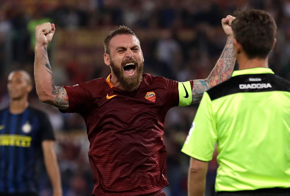 In this Oct. 2, 2016 file photo, Roma's Daniele De Rossi celebrates after his teammate Kostas Manolas scored during a Serie A soccer match between Roma and Inter Milan.