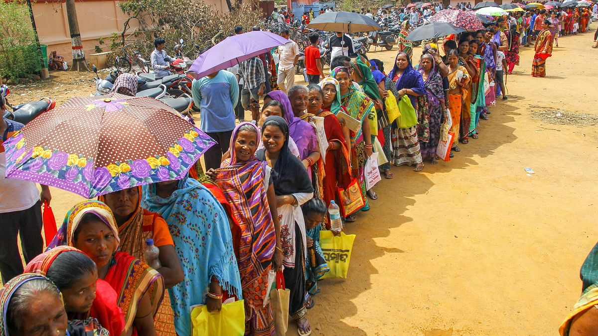 Villagers affected by 'Fani' stand in queue to collect relief material at a camp in Bhubaneswar.