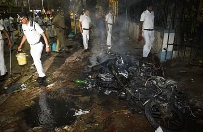 Kolkata: A view of three motorbikes which were set ablaze in the College Street area after Trinamool Congress Chhatra Parishad activists allegedly pelted stones at BJP President Amit Shah