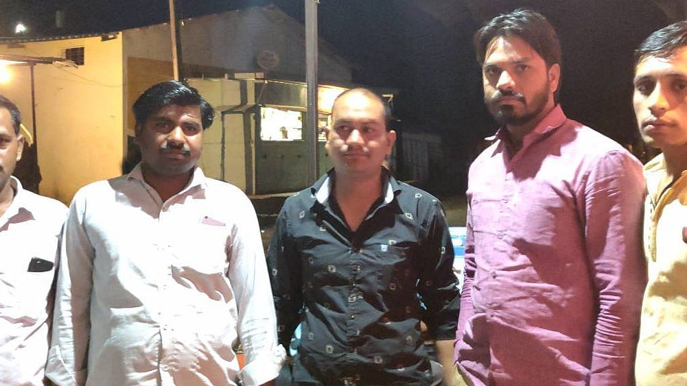 """""""Modiji said he would double our incomes…where are the achhe din [good days]?"""" asks Hridesh Gaur (centre), 34, a farmer from Bhopal district. This traditional BJP stronghold is also angry with the Congress for not keeping its promise of waiving all loans of up to Rs 2 lakh."""