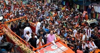 Kolkata: BJP chief Amit Shah during a roadshow ahead of the final phase of 2019 Lok Sabha elections, in Kolkata on May 14 2019. (Photo: IANS)