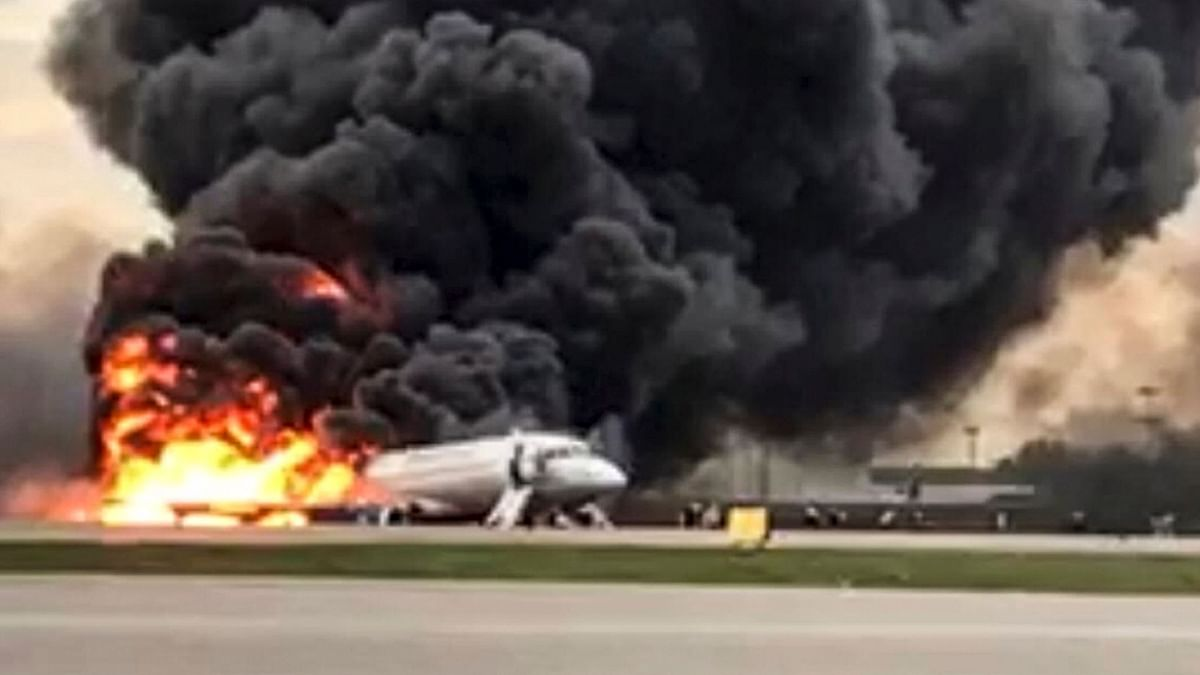 The image shows the Sukhoi SSJ100 aircraft of Aeroflot Airlines on fire.