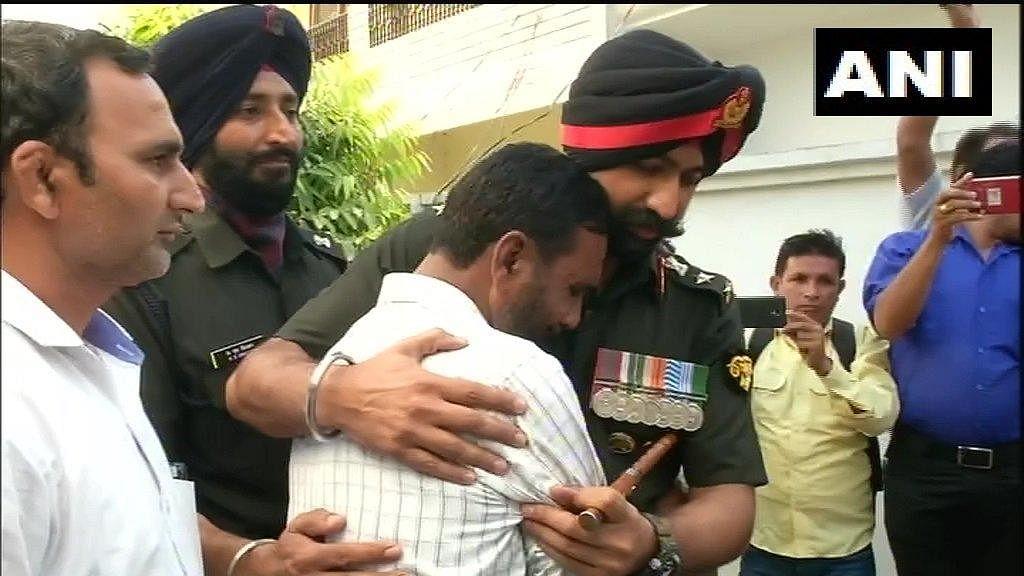 Family of Major Ketan Sharma mourns his demise, at their residence in Kanker Khera.