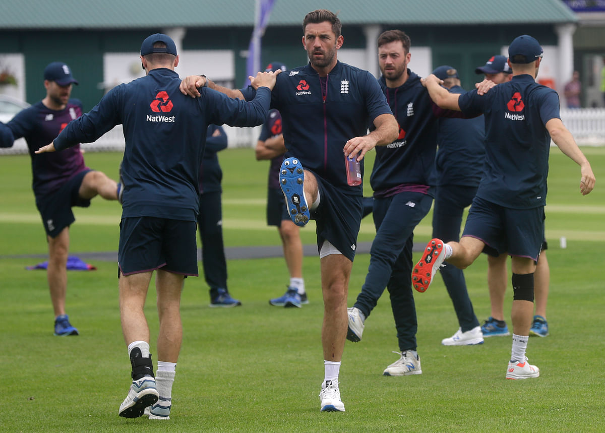 England's Liam Plunkett, centre, stretches with team mates during a training session at Lord's cricket ground in London, Monday, June 24, 2019. England will play Australia in a World Cup cricket match at Lord's on Tuesday.