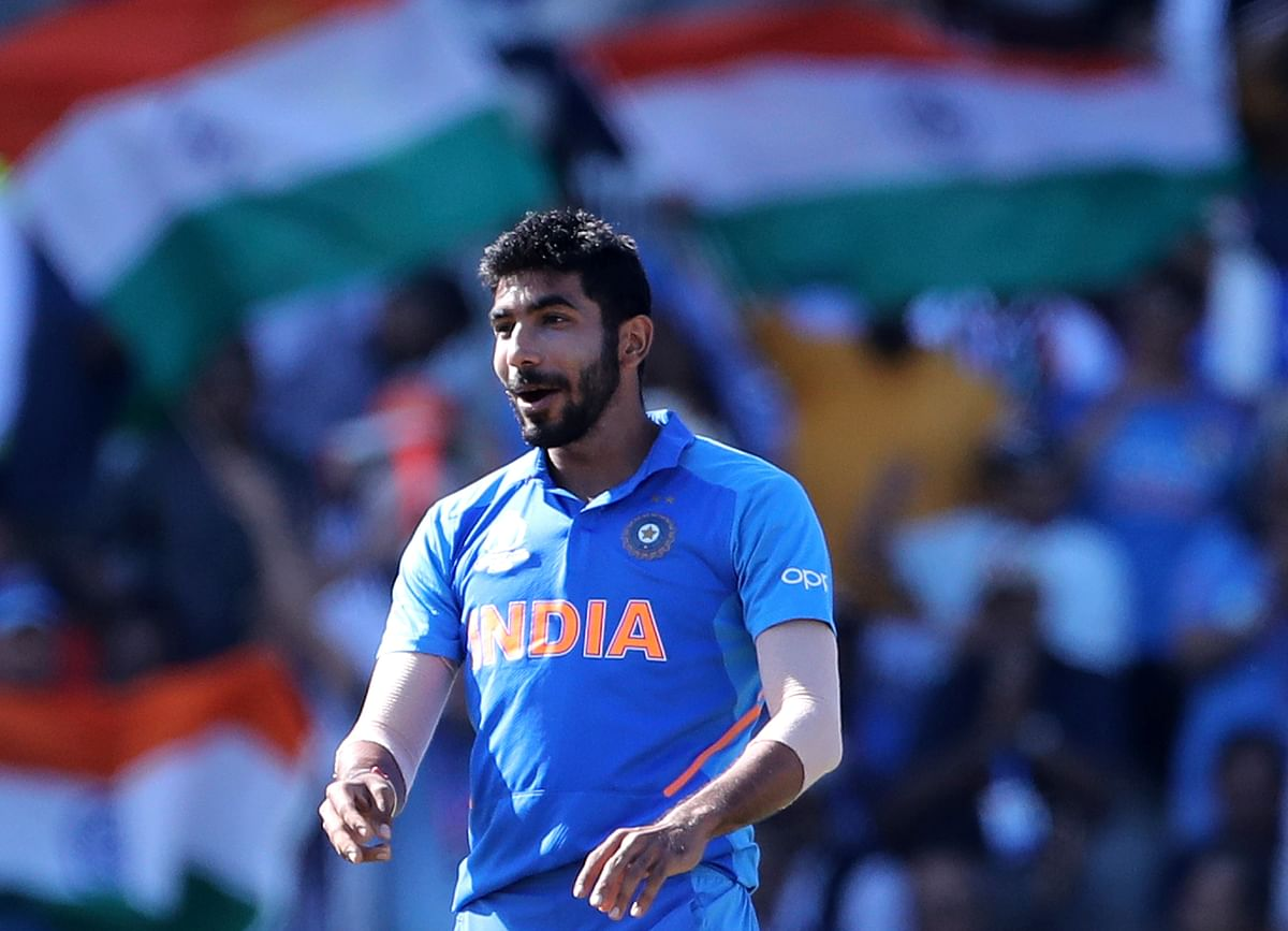 India's Jasprit Bumrah celebrates the dismissal of West Indies' Carlos Brathwaite during the Cricket World Cup match between India and West Indies.