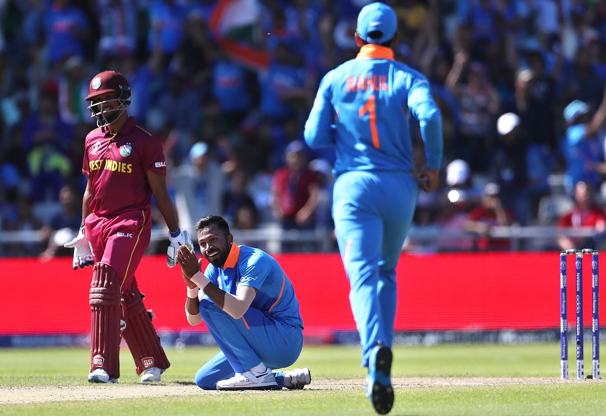 India's Hardik Pandya, center, celebrates the dismissal of West Indies' Sunil Ambris during the Cricket World Cup match between India and West Indies.
