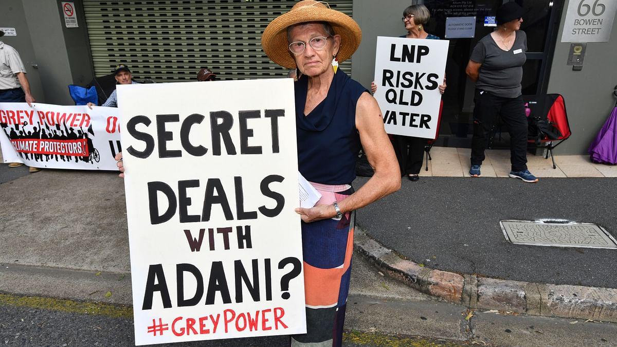 Anti-Adani coal mine protesters seen outside the LNP (Liberal National Party) headquarters in Brisbane, Australia.