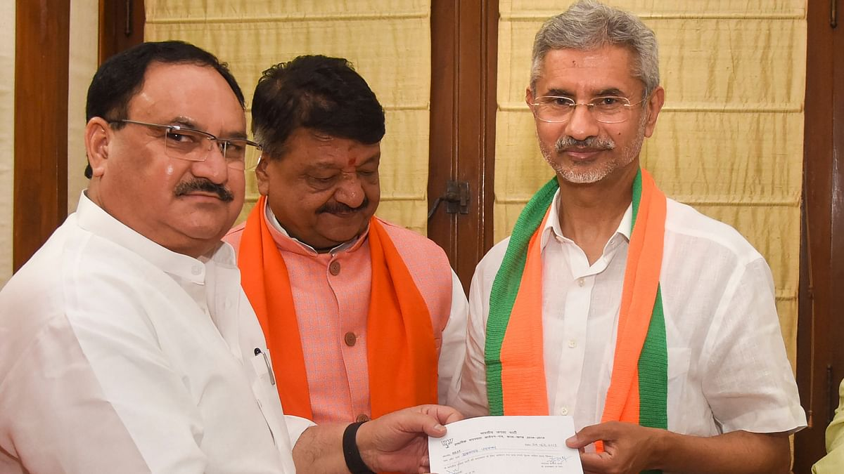 BJP Working President JP Nadda presents a membership slip to External Affairs Minister, S Jaishankar, as he formally joins Bharatiya Janata Party (BJP).