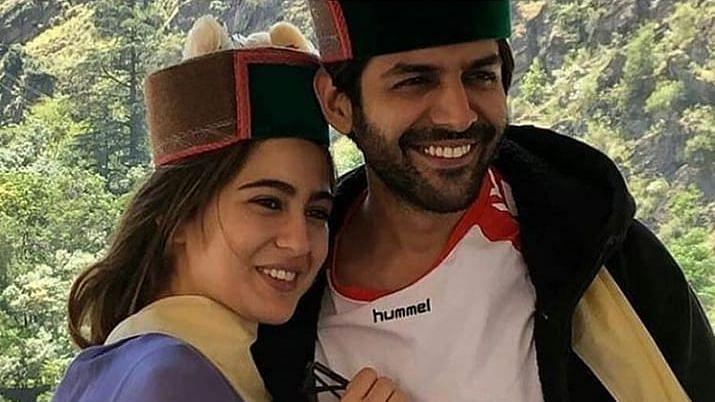 Kartik Aaryan and Sara Ali Khan in Himachali caps