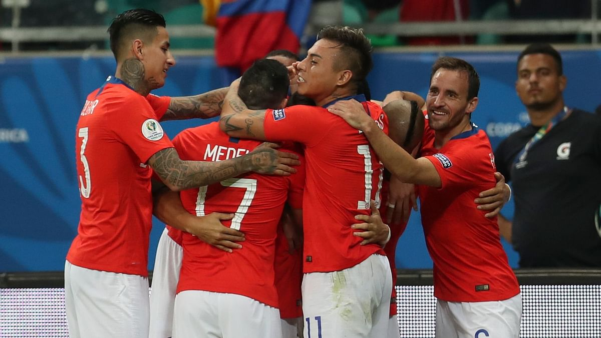 Chile's players celebrate their side's 2nd goal scored by  Alexis Sanchez.