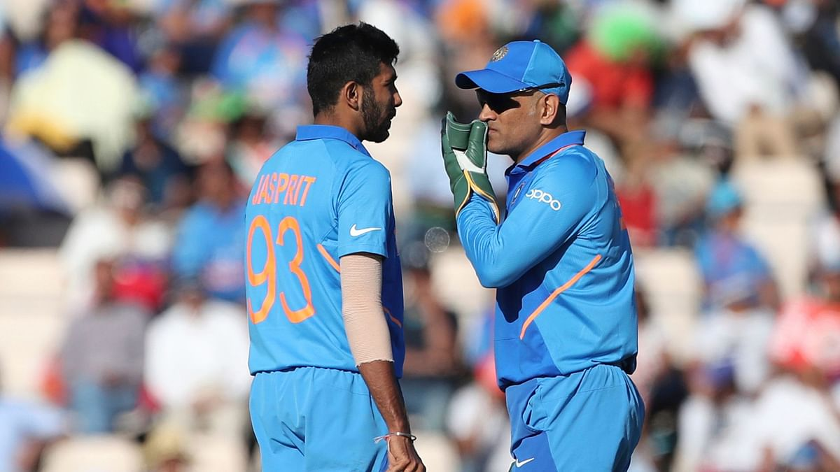 MS Dhoni is often seen discussing strategies with bowlers during a match.