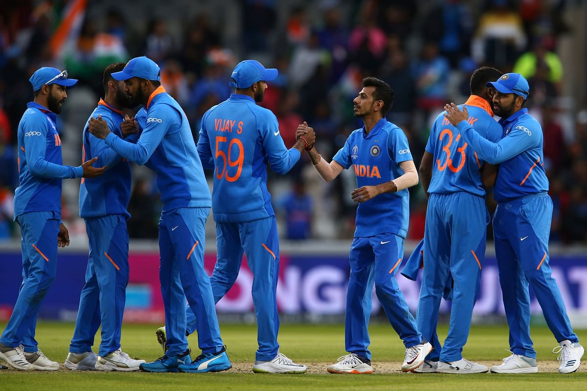 India cricket team celebrate end of the Cricket World Cup match between India and Pakistan at Old Trafford in Manchester, England, Sunday, June 16, 2019.