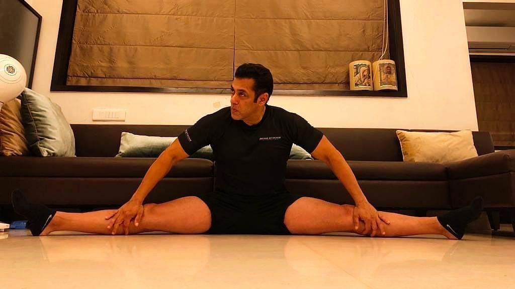 Salman Khan does a split.