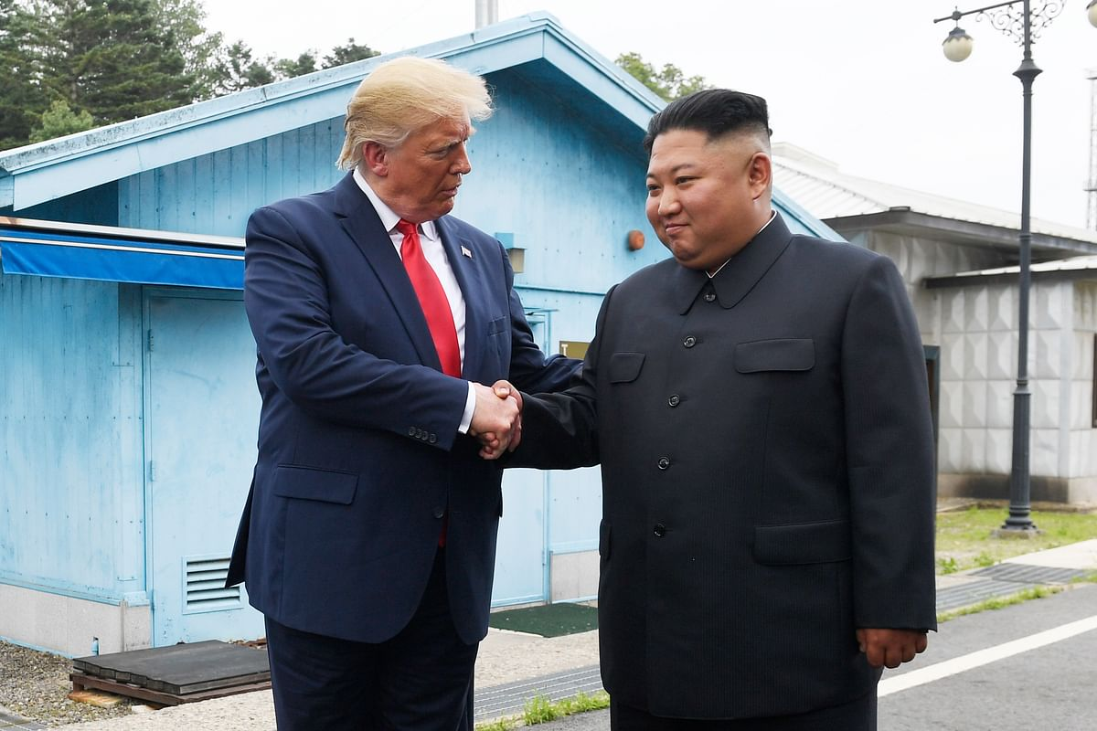President Donald Trump meets with North Korean leader Kim Jong Un at the border village of Panmunjom in the Demilitarized Zone, South Korea, Sunday, 30 June, 2019.