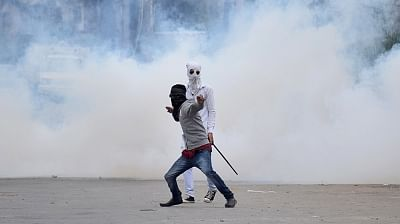 A protester pelts stones on security personnel. (File Photo: IANS)