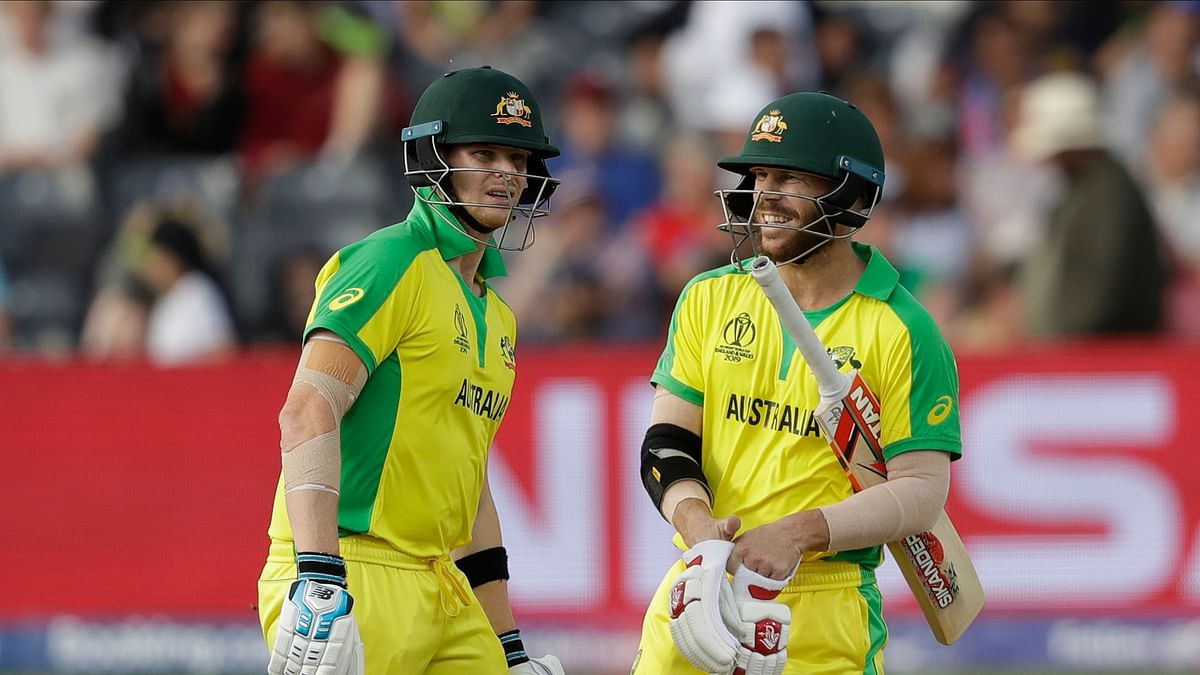 Australia's Steve Smith, left, and Australia's David Warner chat after their first batting over together during the Cricket World Cup match between Afghanistan and Australia at Bristol County Ground in Bristol, England, Saturday, June 1, 2019.