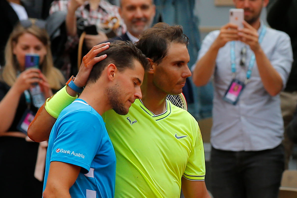 Spain's Rafael Nadal, right, hugs Austria's Dominic Thiem, left, after celebrating his record 12th French Open tennis tournament title after winning his men's final match in four sets, 6-3, 5-7, 6-1, 6-1, at the Roland Garros stadium in Paris, Sunday, June 9, 2019.