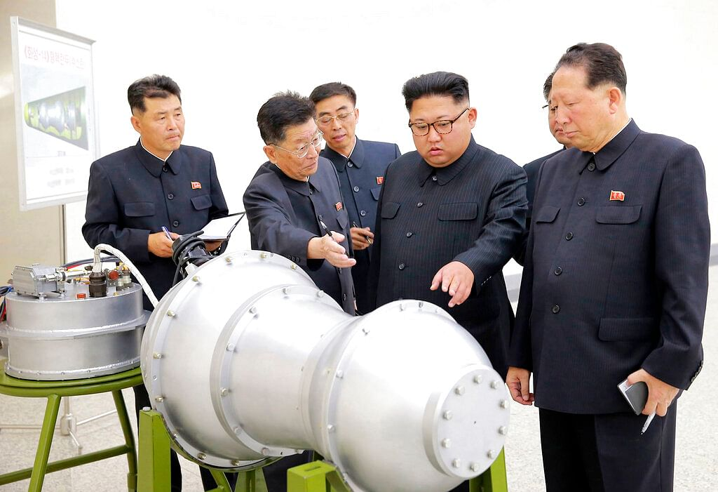 This undated file photo  by the North Korean government shows North Korean leader Kim Jong Un, second from right, at an undisclosed location in North Korea.