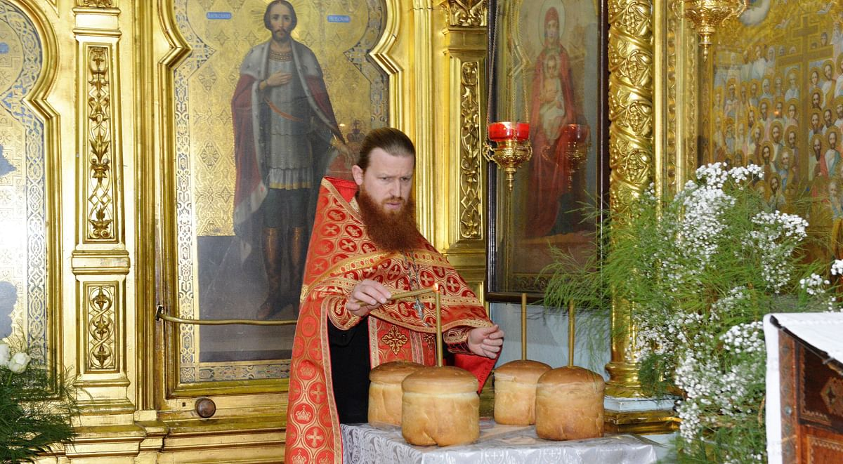 A priest lights a candle inside St Theodor Tiron Cathedral in Moldova's capital Chisinau