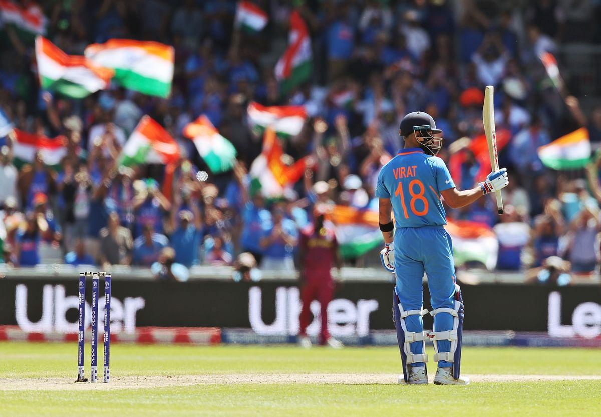 Virat Kohli celebrates his half century vs West Indies.