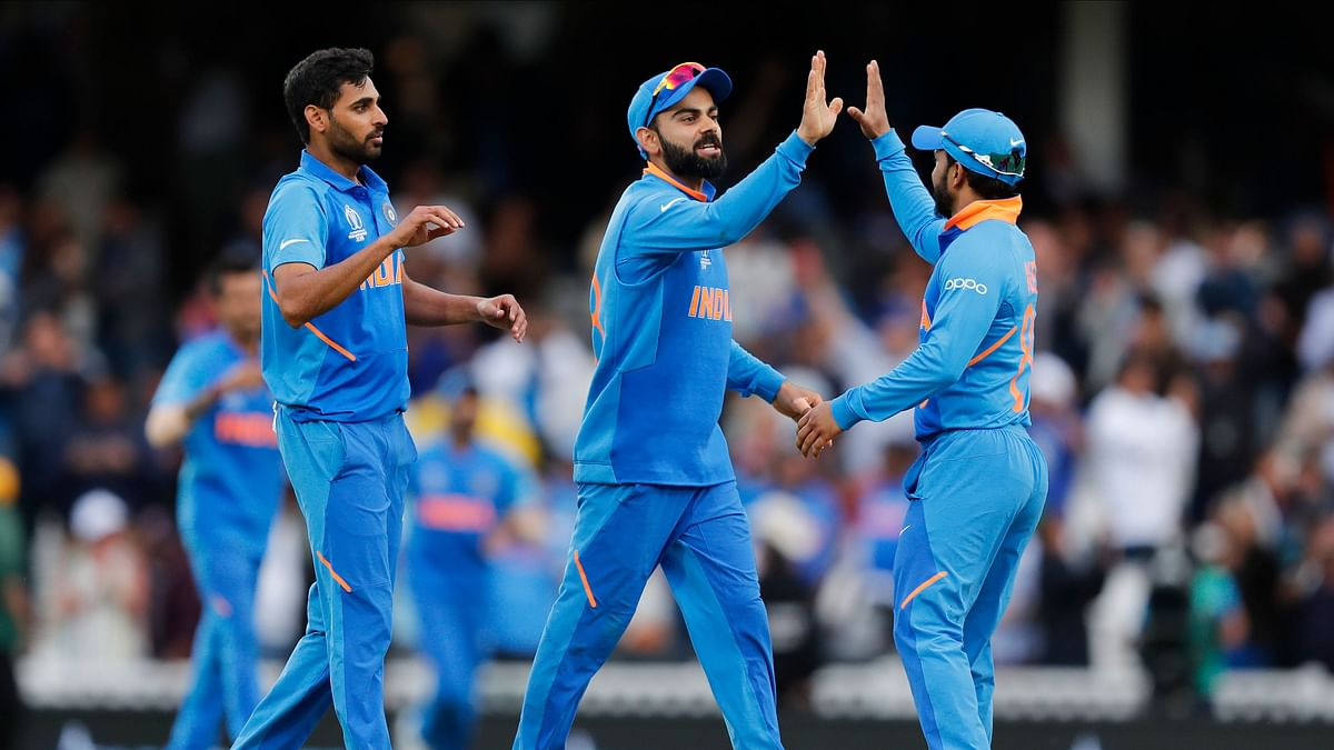 The Indian team celebrates after winning the World Cup match against Australia.