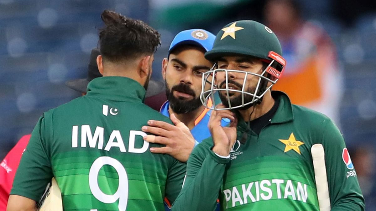 India's captain Virat Kohli, center, greets Pakistan players at the end of the Cricket World Cup match between India and Pakistan.