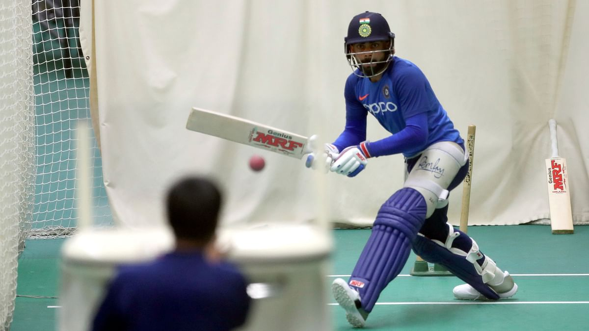 India's captain Virat Kohli bats in the nets using a bowling machine during an indoor training session.