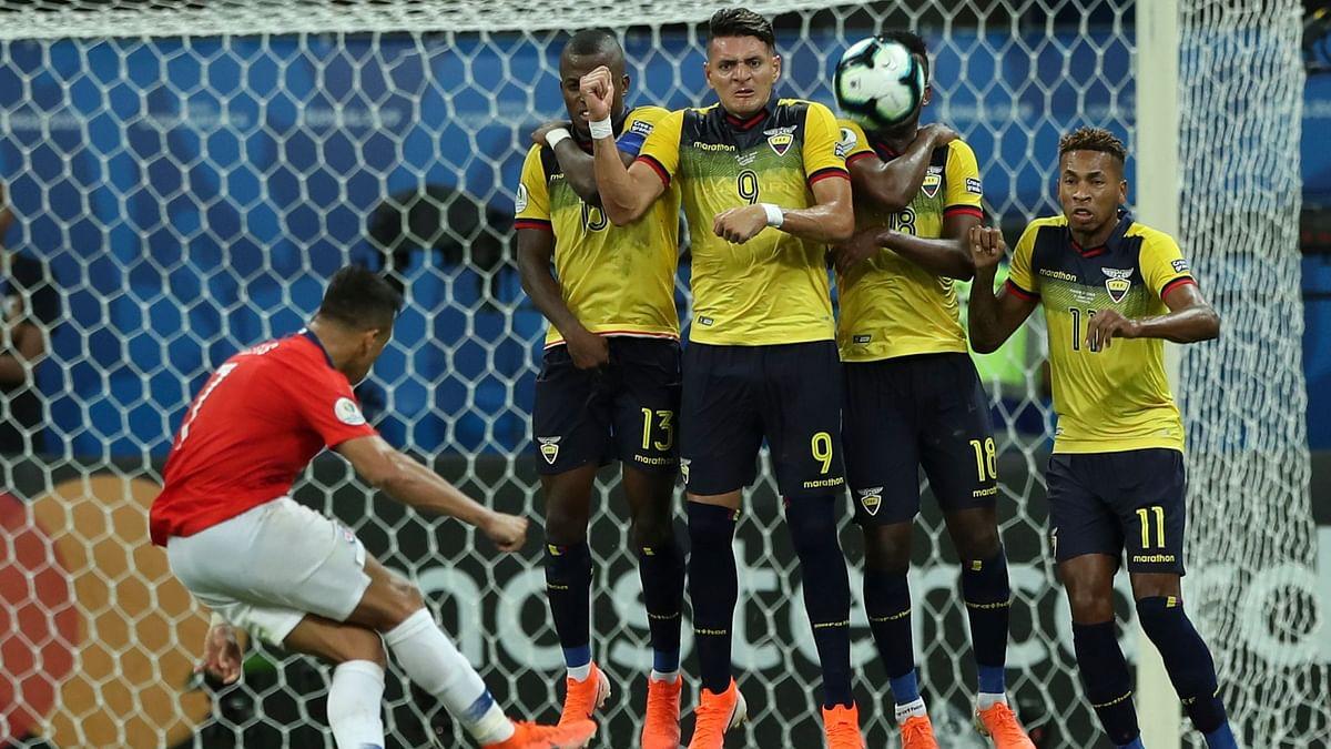 Ecuador's players block a shot by Chile's Alexis Sanchez.