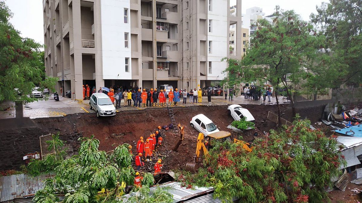 Rescue efforts at the site of the wall collapse in Kondhwa, Pune.