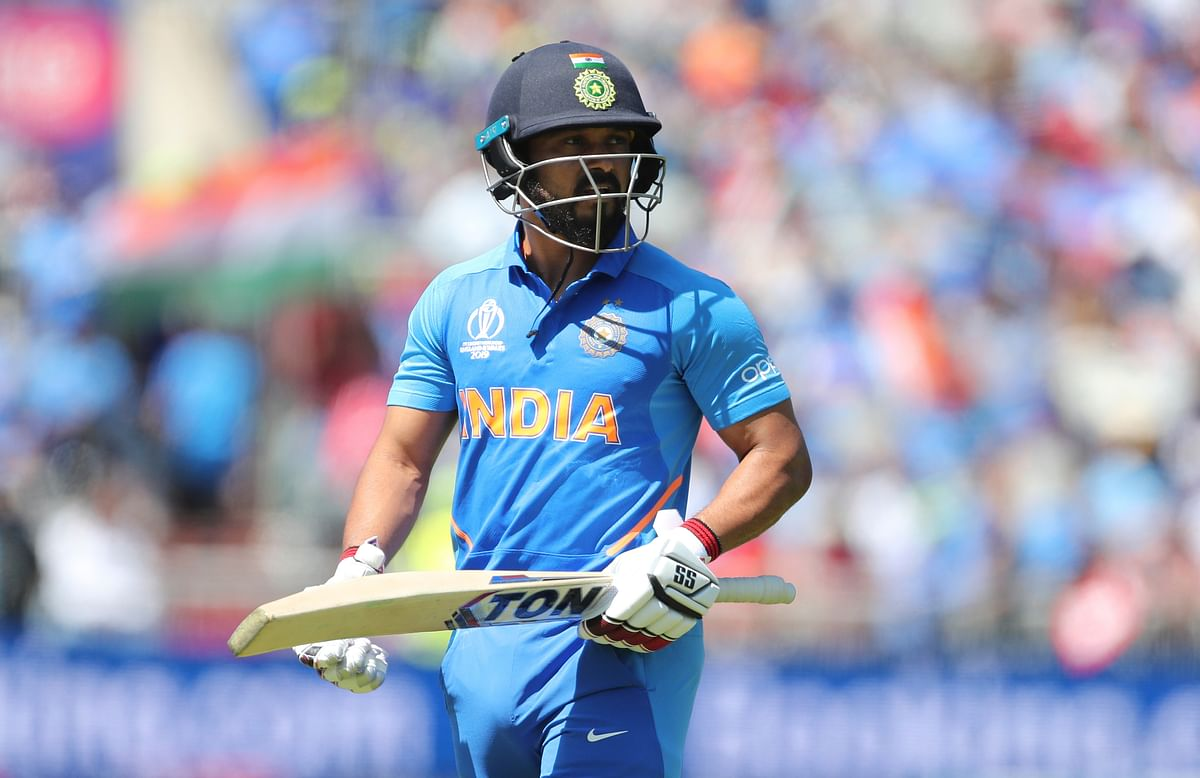India's Kedar Jadhav leaves the field after being dismissed by West Indies' Kemar Roach during the Cricket World Cup match between India and West Indies.