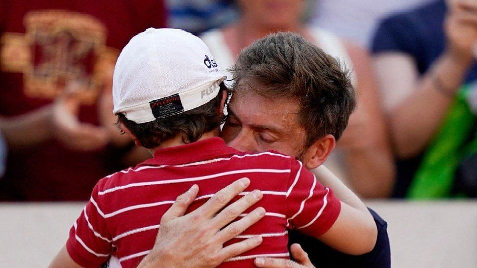 Mahut was consoled by his 7-year-old son after his loss at the French Open.