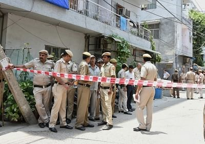 New Delhi: Delhi police deployed outside the house, where a couple and a maid were found dead with their throats slit inside a house in New Delhi