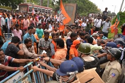 Asansol: BJP workers protesting against the ongoing political violence in West Bengal,