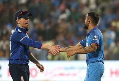 Indian captain Virat Kohli shakes hands with his English counterpart Eoin Morgan.