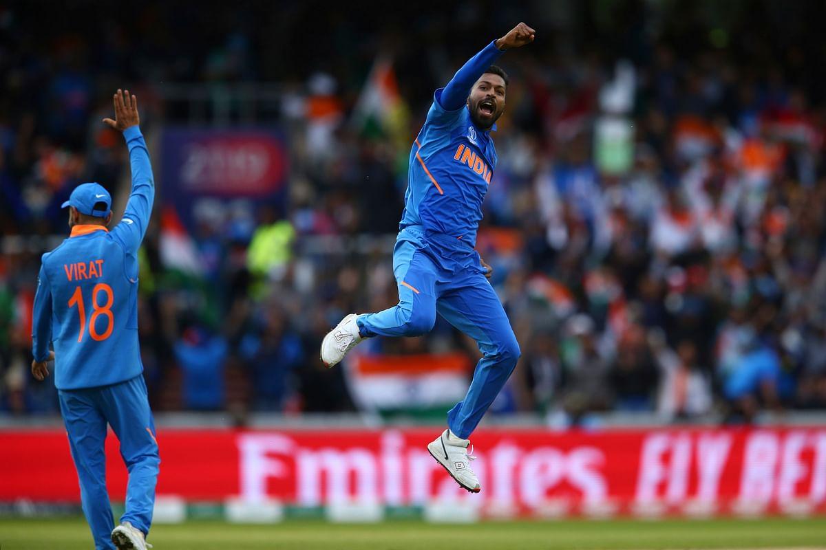 India's Hardik Pandya, right, celebrates taking the wicket of Pakistan's Shoaib Malik during the Cricket World Cup.