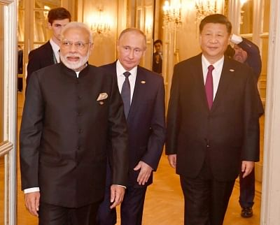 Buenos Aires: Prime Minister Narendra Modi, Russian President Vladimir Putin and Chinese President Xi Jinping at the RIC (Russia, India, China) Informal Summit, in Buenos Aires, Argentina  on Nov 30, 2018. (Photo: IANS/PIB)