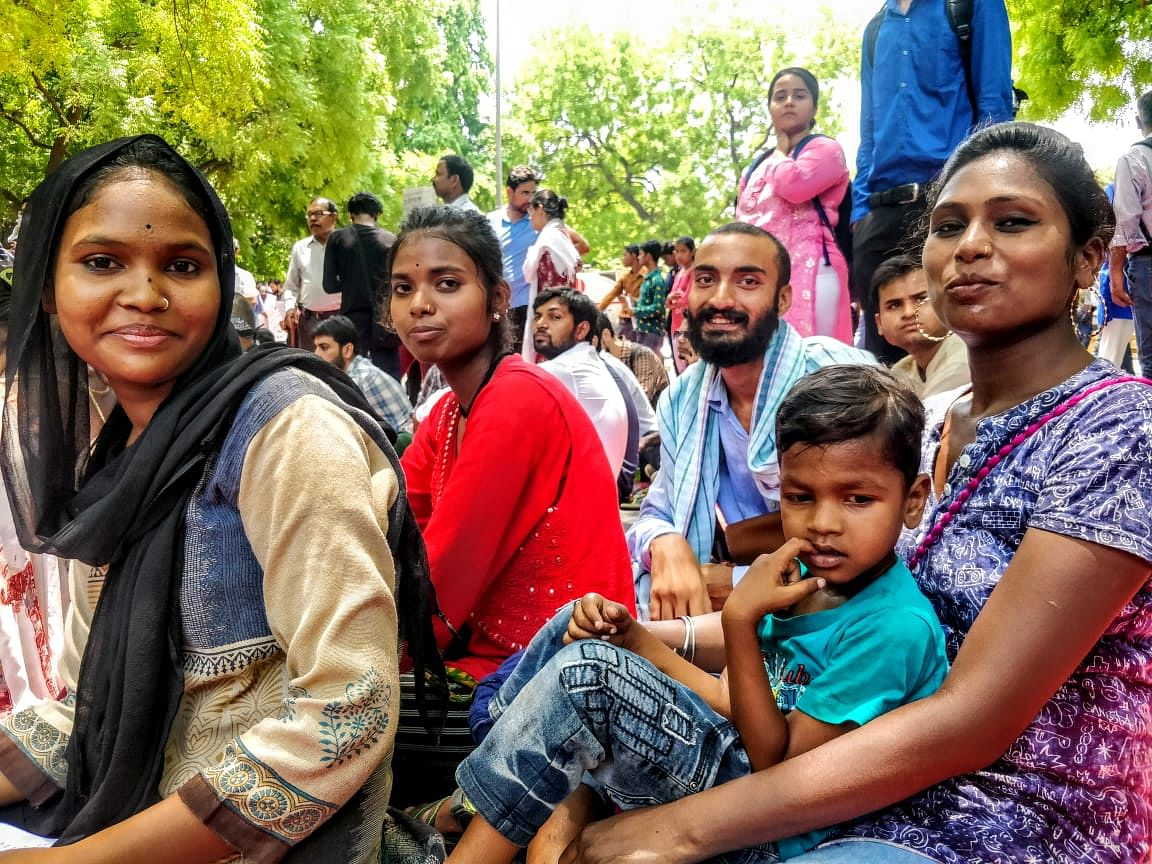 """Rinky, extreme right, has got her son along as well – his first Jantar Mantar protest. """"I want him to understand this world, it is my world,"""" she says."""