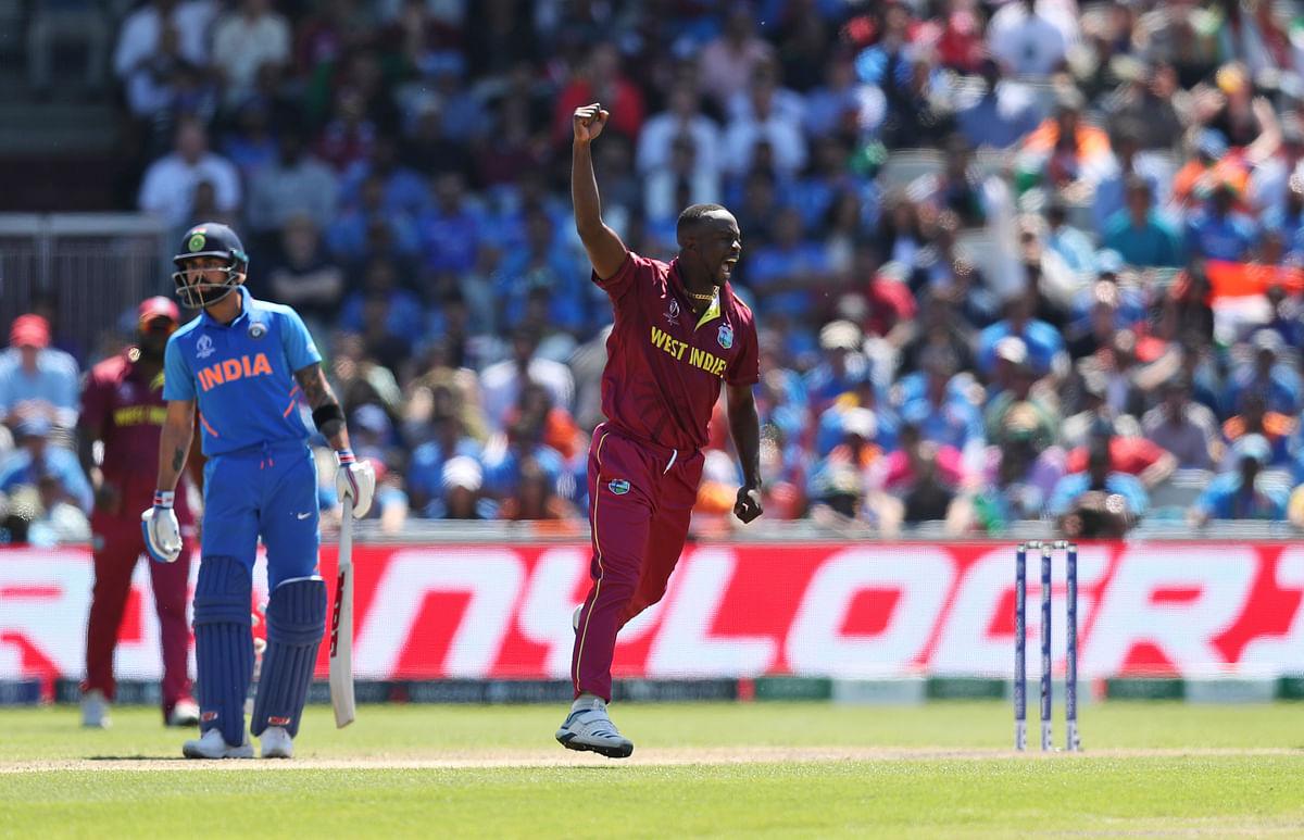West Indies' Kemar Roach celebrates the dismissal of India's Vijay Shankar.