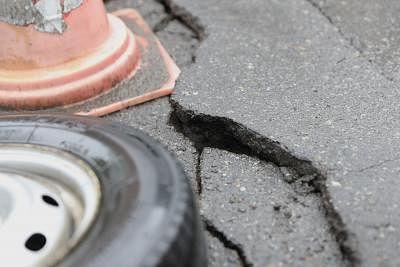 TSURUOKA, June 19, 2019 (Xinhua) -- Photo taken on June 19, 2019 shows the cracks on a road after an earthquake in Tsuruoka, Yamagata Prefecture, Japan. A 6.7-magnitude earthquake striking Japan