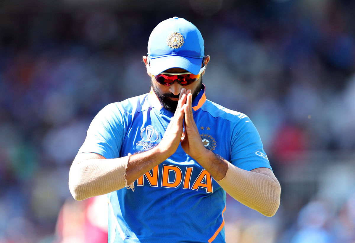 India's Mohammed Shami acknowledges the applause from the crowd after taking two wickets during the Cricket World Cup match between India and West Indies.