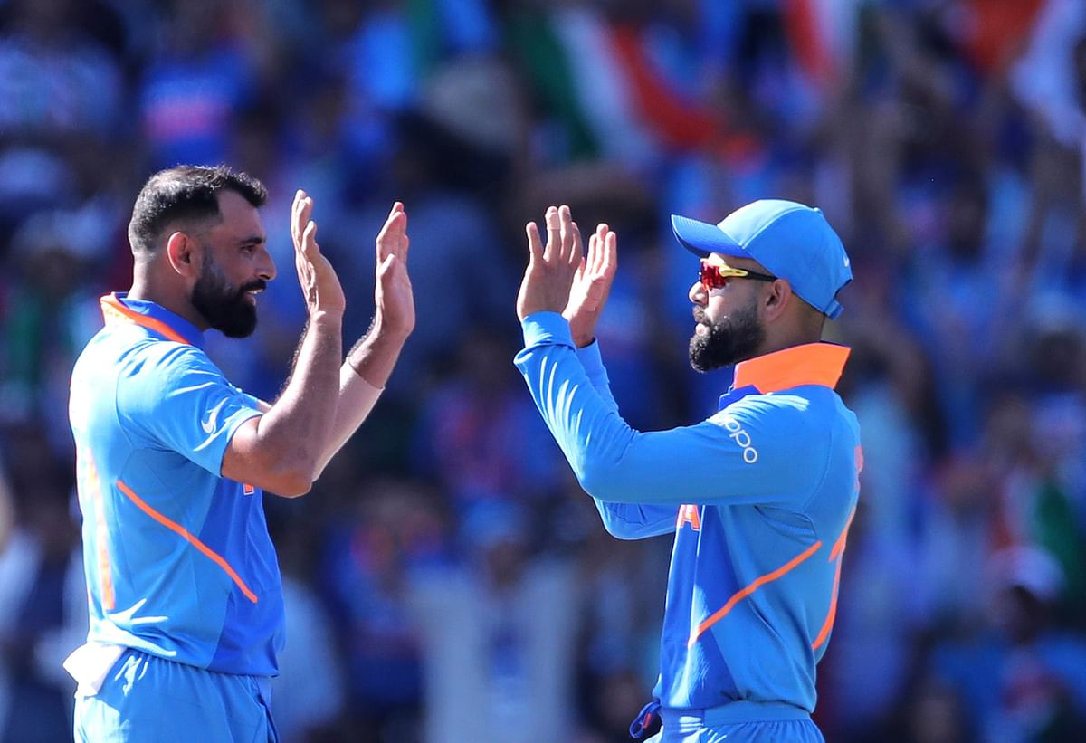 India's Mohammed Shami, left, celebrates with captain Virat Kohli the dismissal of West Indies' Shimron Hetmyer during the Cricket World Cup match between India and West Indies.