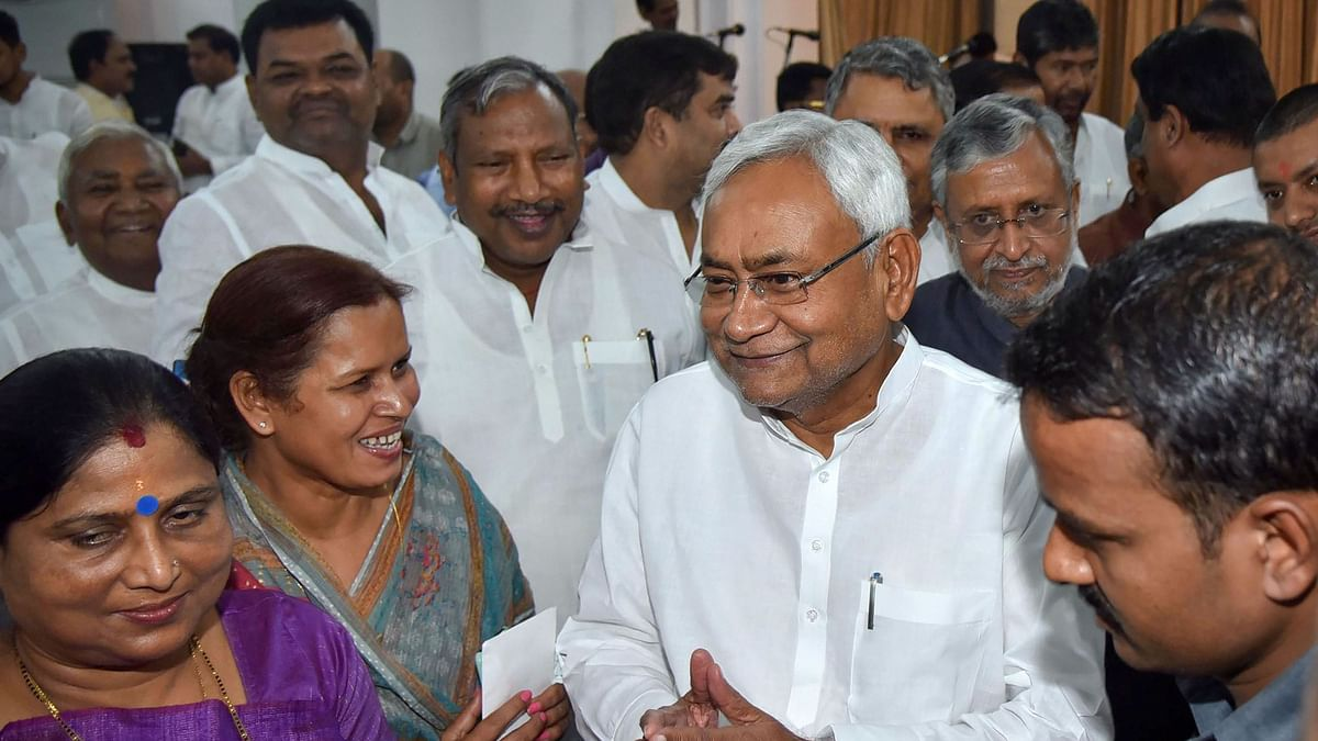 Bihar CM Nitish Kumar along with deputy CM Sushil Kumar Modi during the swearing-in ceremony for the Cabinet expansion  in Patna.