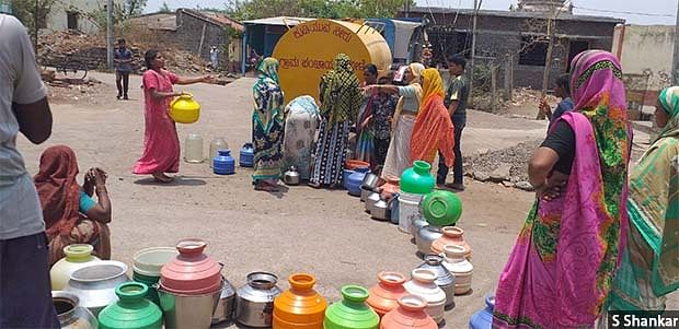 Government water tankers are supposed to provide 40 litres of water per person every day, but the villagers complain that they get only 15-20 litres (two to three pots). A queue at a water tanker in Mole village of Athani taluka in northern Karnataka.