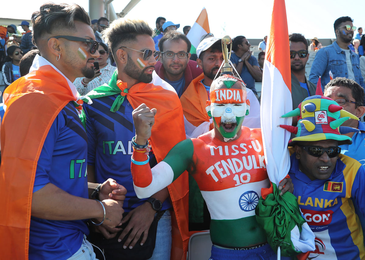 Indian supporters cheer for their team before the start of the Cricket World Cup match between India and West Indies at Old Trafford in Manchester, England.