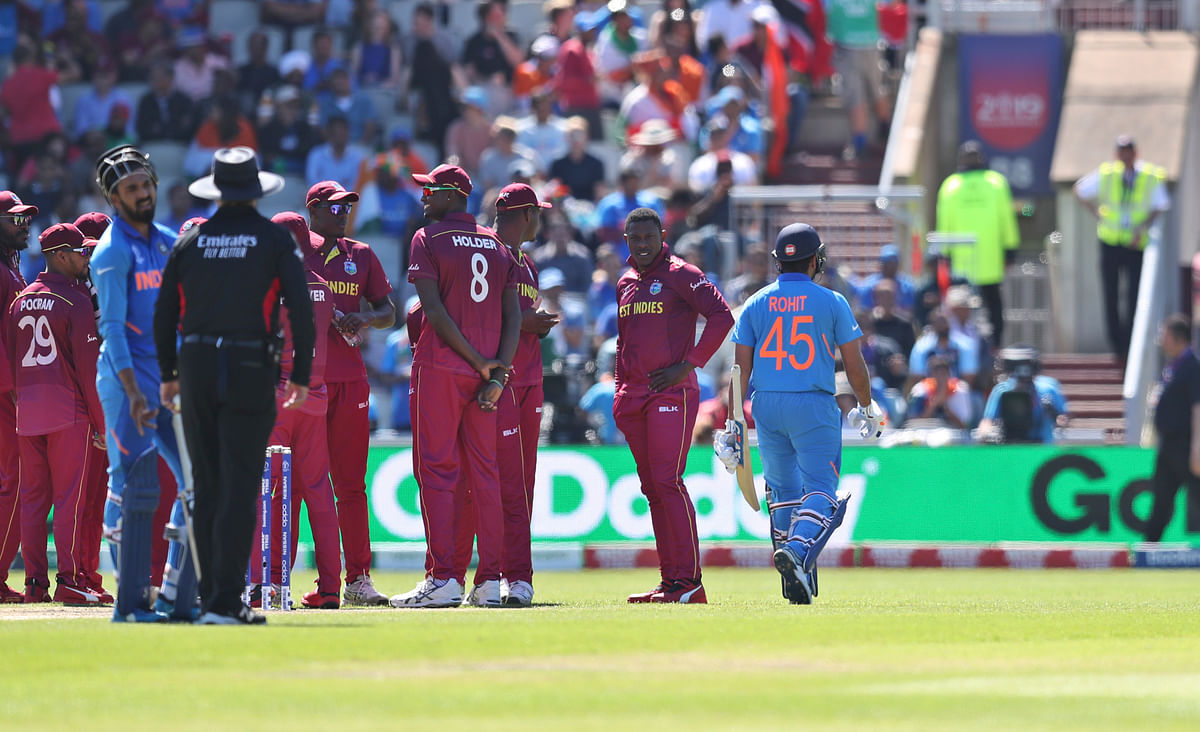 India's Rohit Sharma leaves the field after being dismissed during the Cricket World Cup match between India and West Indies at Old Trafford.