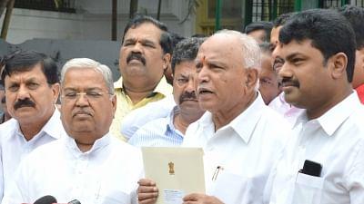 Bengaluru: Karnataka BJP President B. S. Yediyurappa talks to media personnel after meeting Governor Vajubhai Vala, in Bengaluru on July 26, 2019.