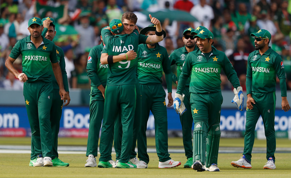 Pakistan's Shaheen Afridi, centre gives a thumbs up as he celebrates with teammates after taking the wicket of Bangladesh's Mahmudullah during the Cricket World Cup match.