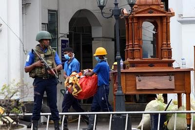 COLOMBO, April 27, 2019 (Xinhua) -- Workers clear away debris and shattered glass amid tight security outside St. Anthony